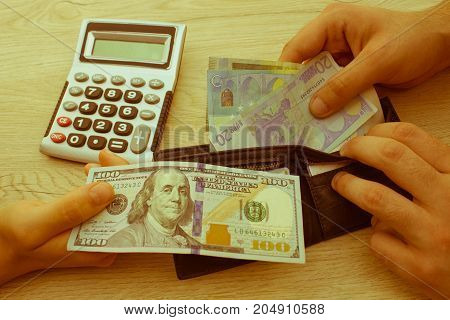 people exchanging money saving and finance concept - close up of male and female hands giving or exchanging money - Retro color
