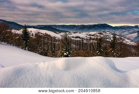 Snowy Hillsides In Mountainous Countryside