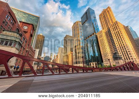 Chicago downtown and Chicago River with bridges during morning.