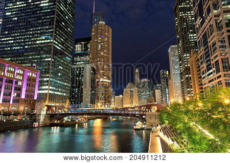 Chicago downtown and Chicago River with bridges at night.