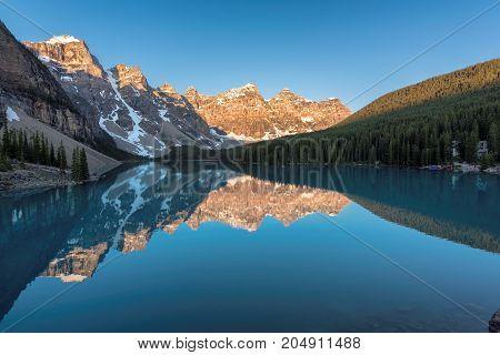 Beautiful Moraine Lake at sunrise, Rocky Mountains, Canada.