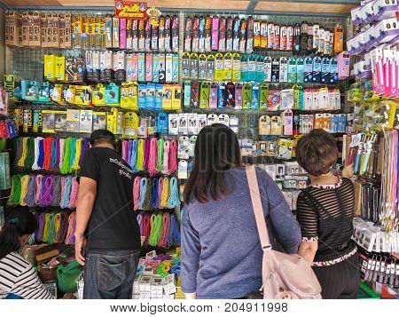 BANGKOK THAILAND - FEBURARY 4 2017: People choose to buy mobile phone accessory at the suapa market on Bangkok Thailand