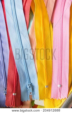 color full zippers in row - stock image