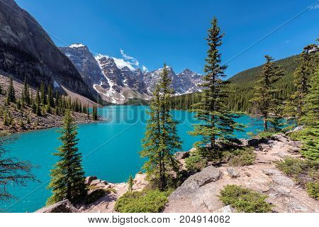 Beautiful turquoise waters of the Moraine lake in Canadian Rockies.