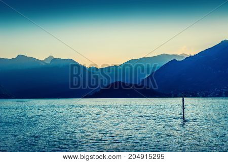 Scenic Alpine Mountains And Como Lake At Sunset