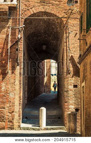 Old alleyway in Siena Tuscany Italy. Architecture