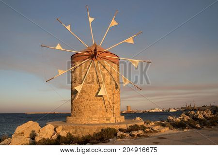 Traditional windmill in Mandraki port of RhodesGreece