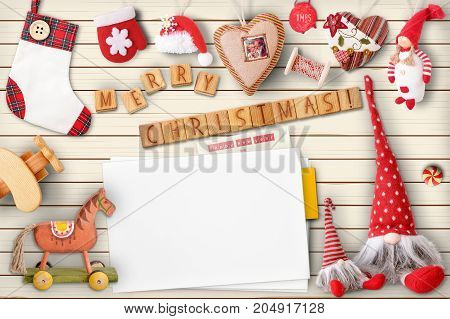 Christmas Greeting Card with Xmas Elements on White Wooden Background. Retro Style. Space for Text.