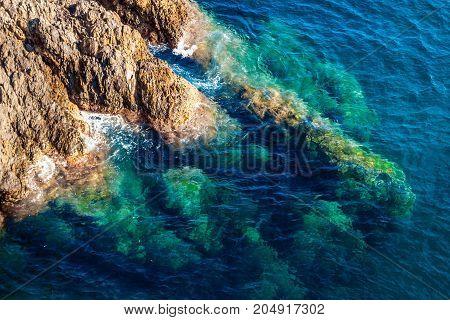 Rocky coast and transparent blue sea. Nature