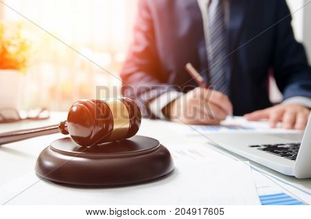 Wooden Gavel On Table. Attorney Working In Courtroom.