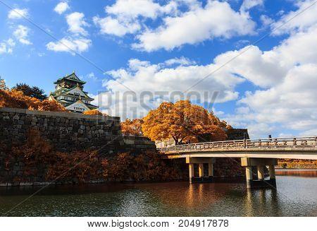 Osaka Castle in Osaka with autumn leaves Japan landmark of Unesco.