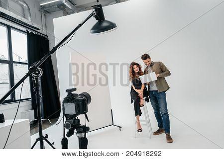 Photographer And Model In Photo Studio