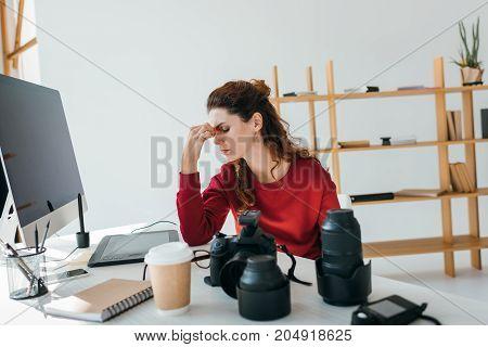 Tired Female Photographer