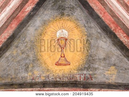 A fresco depicting the sacred chalice of Jesus.