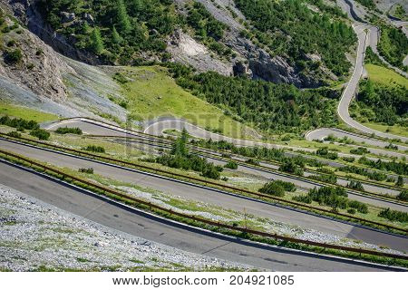 Top view of serpentine road and galleries of Stelvio Pass from above. Bormio side