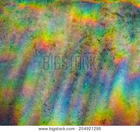 Beautiful abstract multicolored rainbow background (refraction of sun light on a stone background)