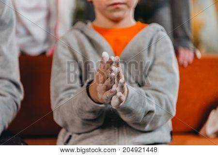 Boy Applying Talcum To Hands