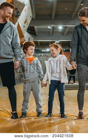 Family Holding Hands At Gym