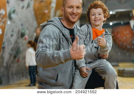 Dad With Son Showing Thumbs Up