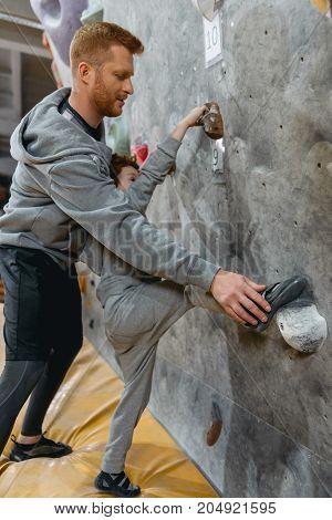 Dad Teaching Son How To Climb