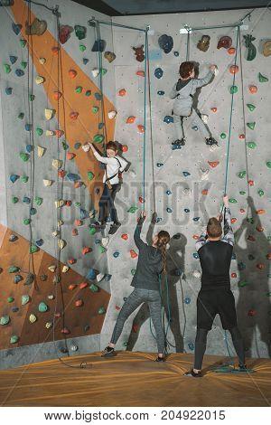 Two Little Kids Climbing Wall