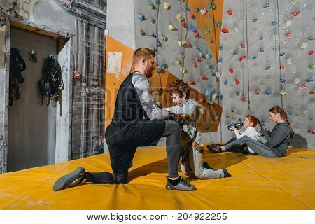 Dad Securing Son In Harness