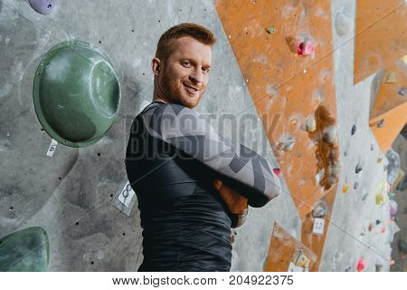 Young Man With Arms Crossed At Gym