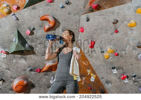 Sportive Woman Drinking Water