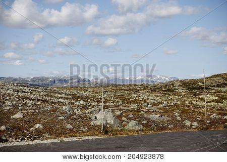 Road Through The Stone Tundra With Landmarks
