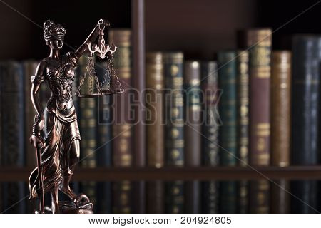 Law theme. Statue of justice in old court library.