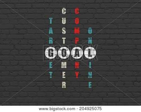 Marketing concept: Painted white word Goal in solving Crossword Puzzle