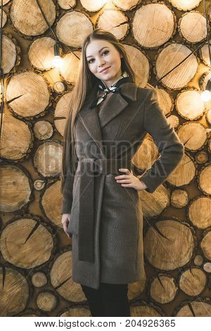 Young fashionable woman in a warm winter coat, autumn