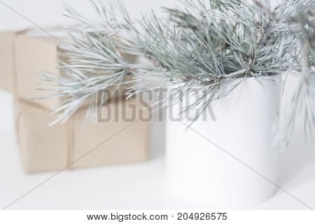 Cozy lifestyle photo of Chrristmas decor background with gift boxes, pinecorn and gold basket