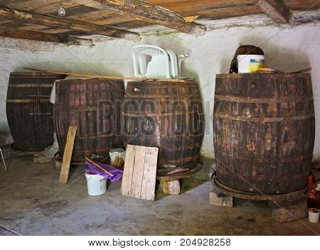 Old wine barrels in cellar, not in usage any more