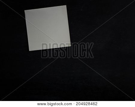 Empty paper sheet on blackboard background for add text message.