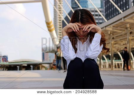 Young businesswoman feeling failure and frustrated with her work. Stressed business concept. Selective focus and shallow depth of field.