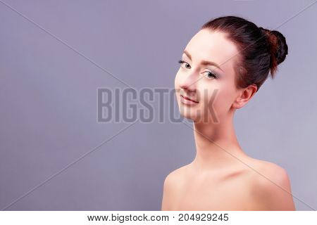 Portrait of happy young attractive female / woman / girl with bare shoulders