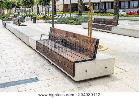 SPLIT, CROATIA - 13 JULY, 2017: White bench in the center of Split, Croatia