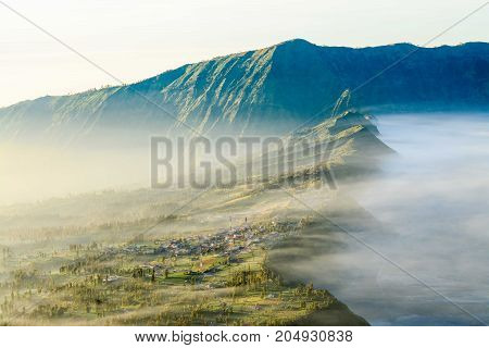 View of Cemoro lawang village from Penanjakan1 view point at Tengger Semeru National Park East Java Indonesia, Cloud and cold over the village.