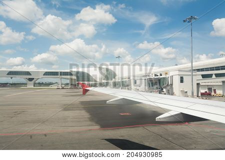 Kuala Lumpur international airport Malaysia - Aug 14 2017: Aircraft or plane is parking at the airport with blue sky background.