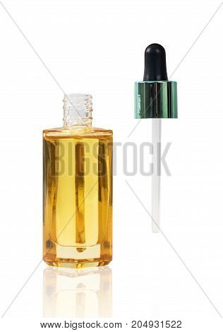 Bottle of the gold cosmetic oil with pipette isolated on white background.