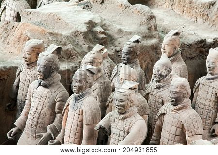 XIAN,CHINA - NOVEMBER 11, 2011:The Terracotta Army or Terra Cotta Warriors buried in Qin Shi Huang Emperor's tomb in 210-209 BC.