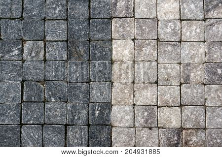 Background of old European cobblestones. A horizontal frame.