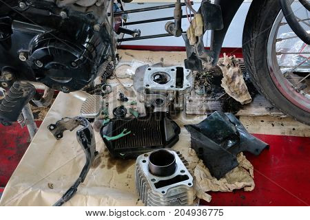 The motorcycle was dismantled for repair in garage.