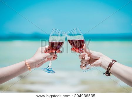 Young Asian woman drinking a glass of wine together.