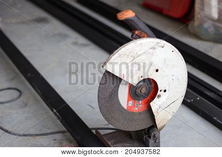 industrial equipment men working cutting metal tool
