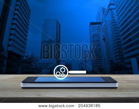 seo flat icon on modern smart phone screen on wooden table over office city tower Search engine optimization concept