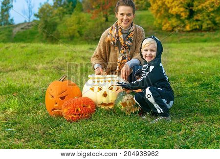 Mother And Daughter Among Halloween Pumpkins Jack O'lantern