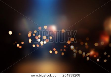 Dark background with colored bokeh and light effects for a celebratory presentation