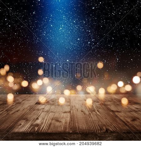Christmas background with golden bokeh and blue light beam for a presentation